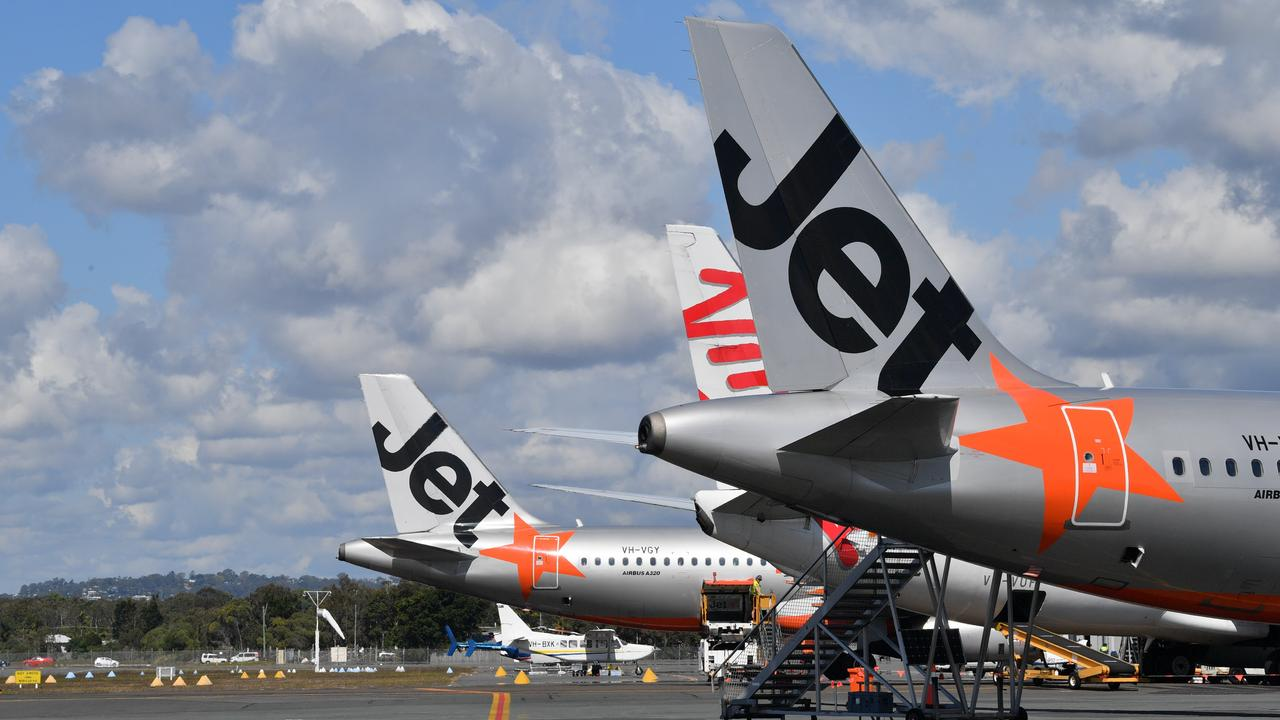 Jetstar and Virgin planes on the tarmac at Sunshine Coast Airport.