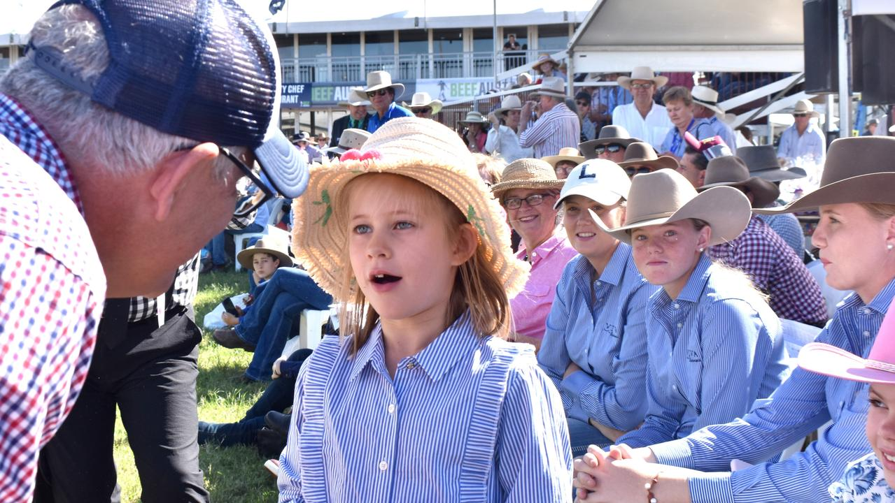 Prime Minister Scott Morrison speaking with Pippa King from Goondiwindi in the centre ring at Beef Australia