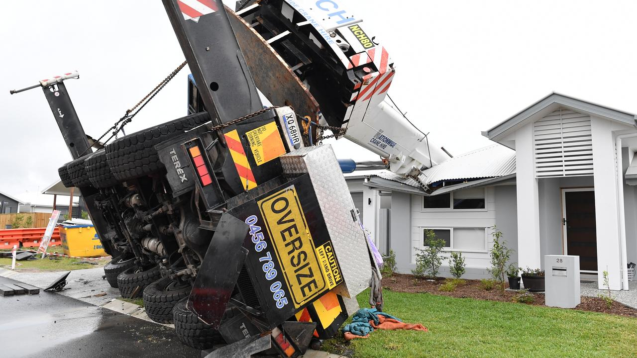 Three houses were damaged when a crane toppled over at Nirimba on Friday afternoon. Picture: Patrick Woods.