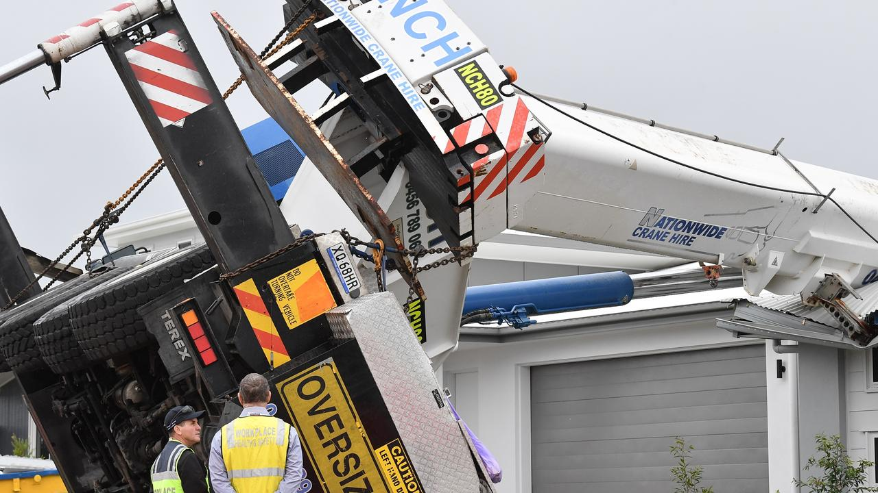 A family whose home was hit by an 80-tonne crane in a freak accident last week could be forced to move hundreds of kilometres to put a roof over their heads.