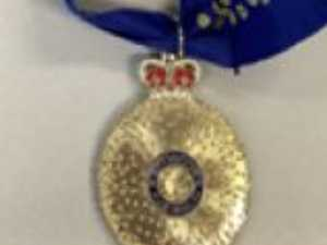 Man charged after allegedly faking medals to lure business
