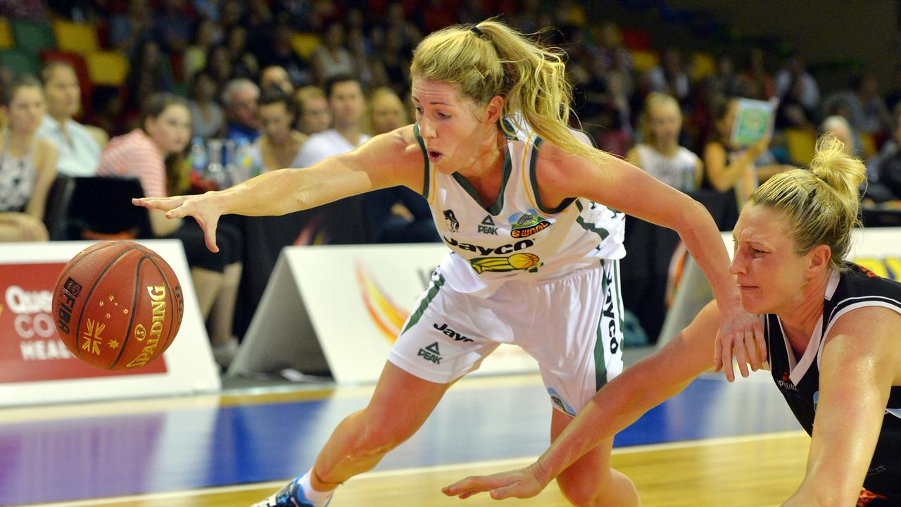 Ranger's Kathleen MacLeod and Fire's Suzy Batkovic in action during a WNBL game in 2014. Picture: Wesley Monts