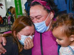 Mum's 477-day wait for a hug over as first NZ flight lands