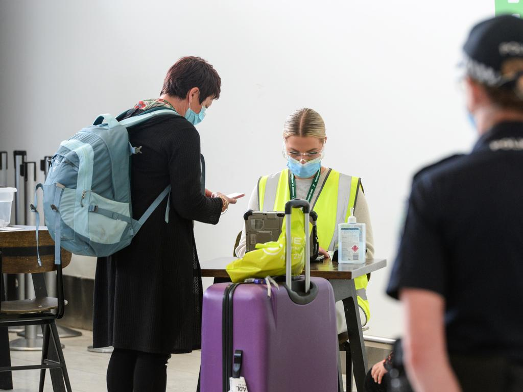 Travellers answered COVID-19 questions after arriving from Auckland. Picture: NCA NewsWire / Brenton Edwards