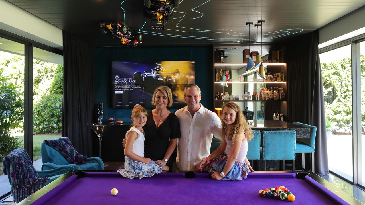 V8 Supercar driver Paul Weel and his wife Emma, with daughters Mila 8 and Abby 10, are selling their main river home at Carrara, which they built from scratch. Picture Glenn Hampson