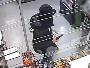 WATCH: Man robs convenience store with handgun