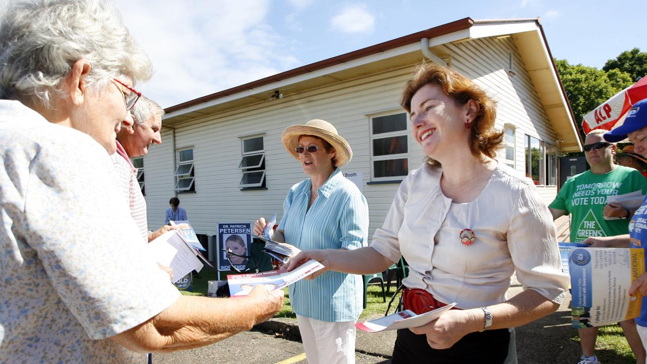 Ipswich Rachel Nolan hands out how to vote cards during the 2021