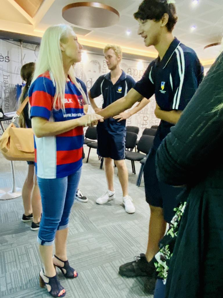 Melissa McGuinness being comforted by Paros Tahi, 16, after her road safety speech at the Australian Trade College, Robina.