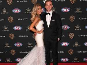 Footy power couple quietly splits