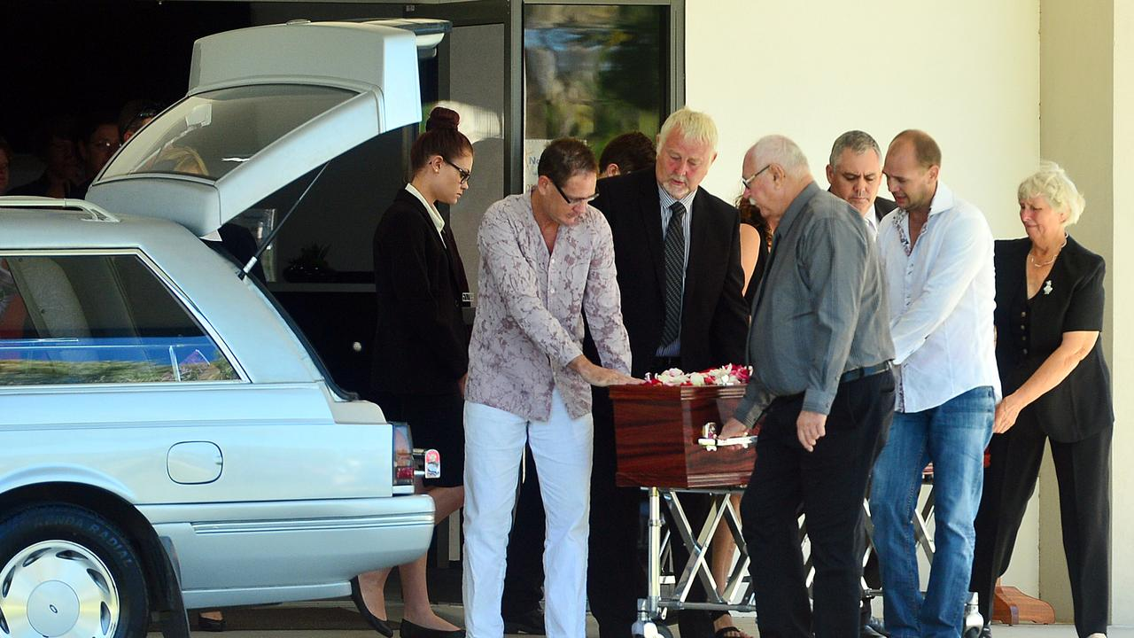 Family carry Ruth Dodd's casket into a hearse after her funeral.