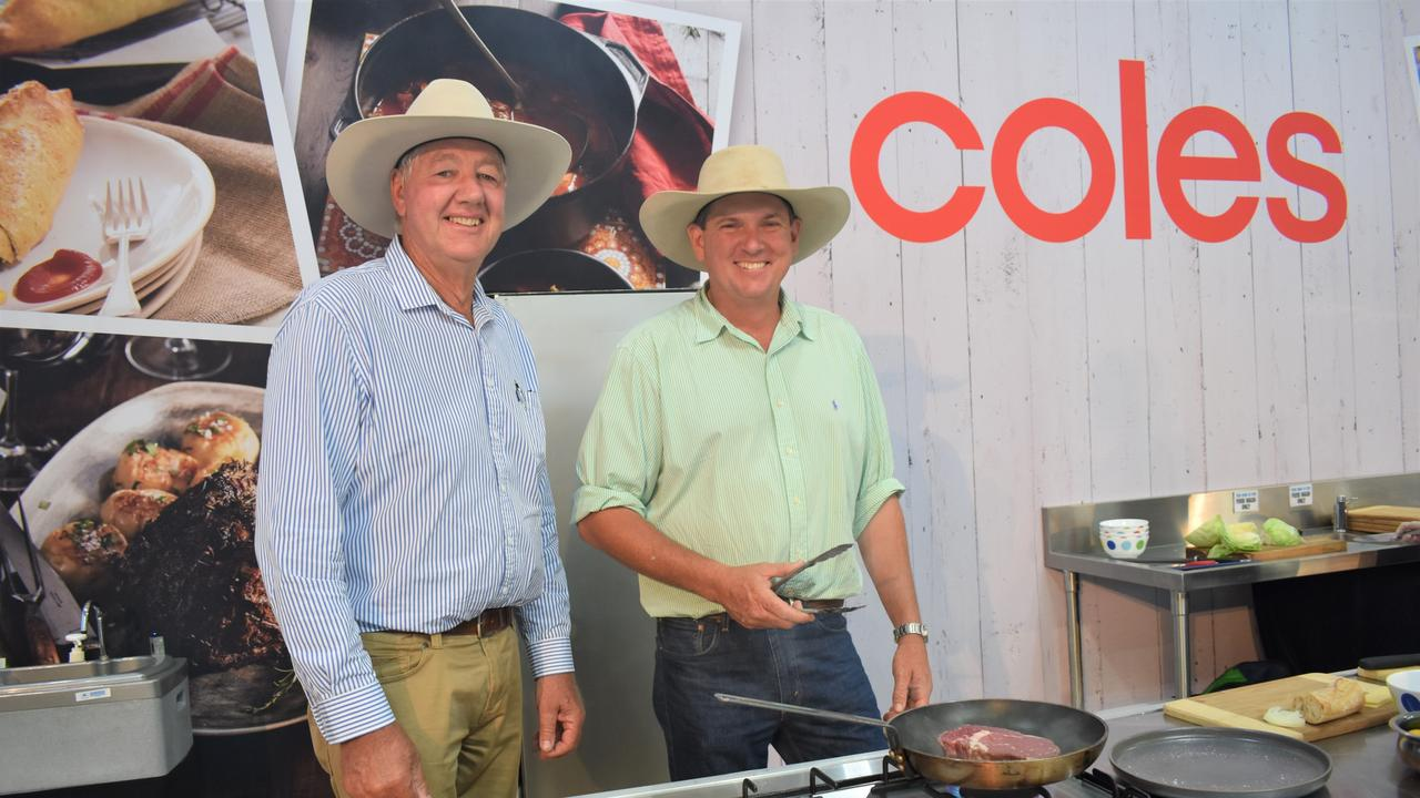 Andrew and son Joe Simmons of Taroom cooking a steak at the Beef Australia Coles kitchen.