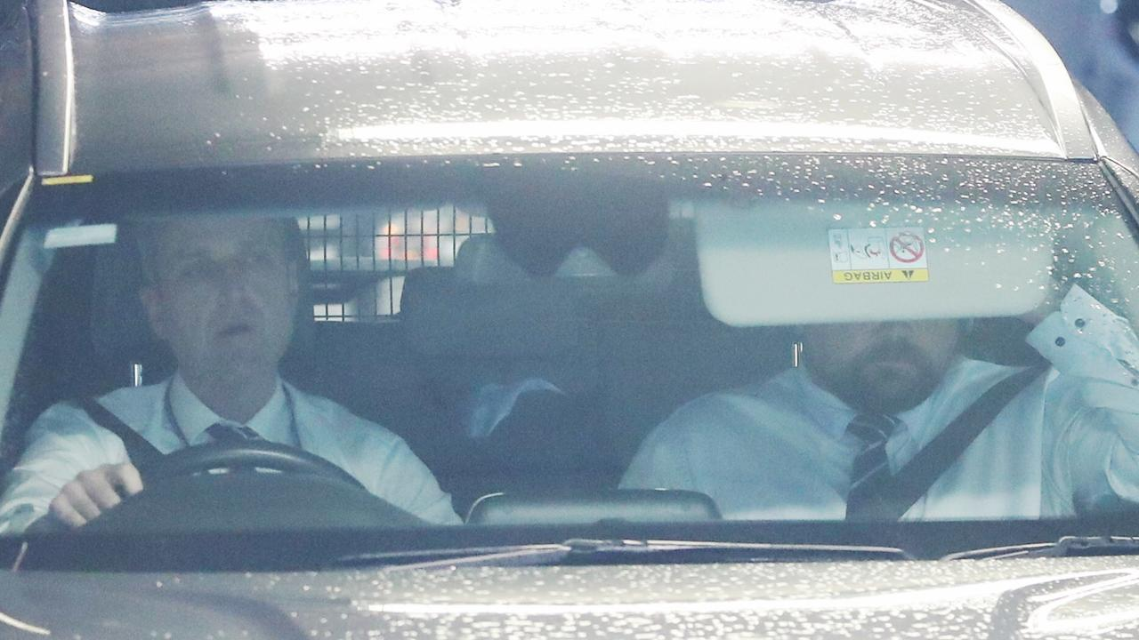 MacGill was seen hiding in the back seat of a police car on Wednesday morning. Picture: John Grainger