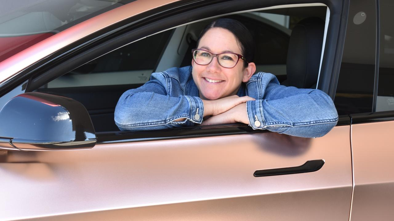 Micky Hasted and her husband bought an electric car last year and say it's zippy, low-maintenance and quick to charge. Photo: Ebony Graveur