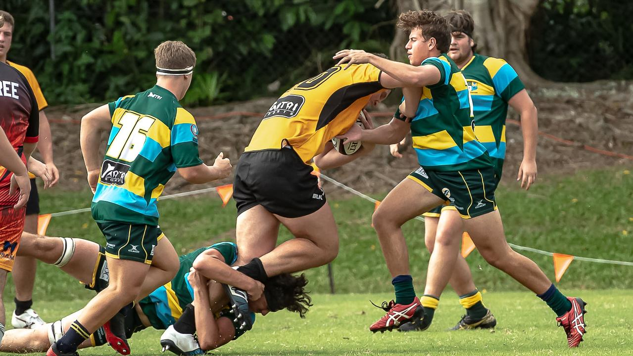 Josh Mostert tacking on an opponent while representing SEQ. Picture Chris Lodge