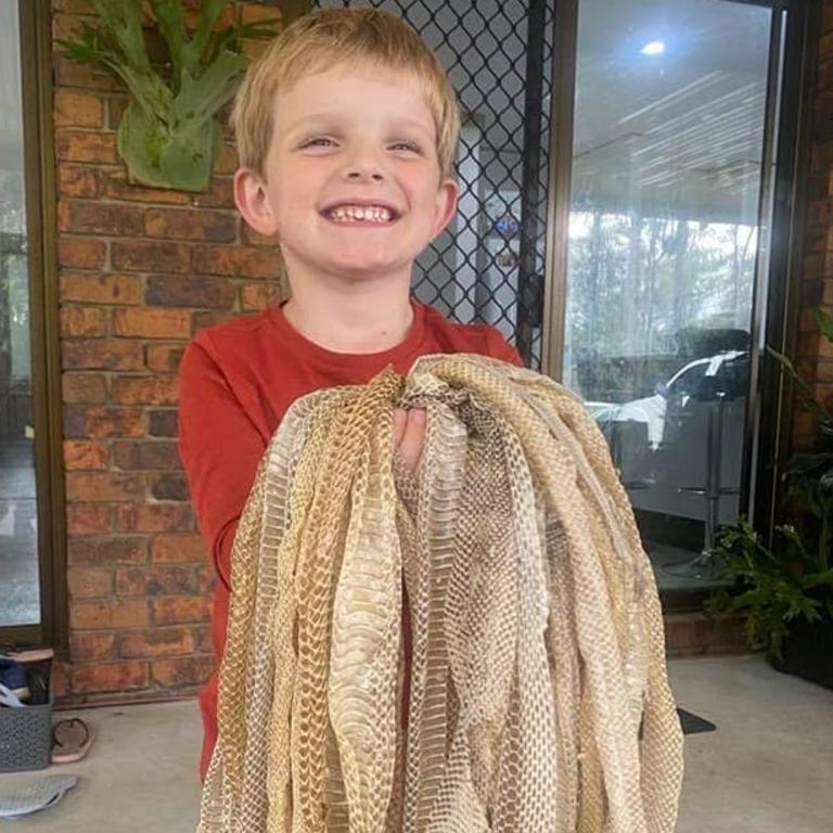 One of the kids with the skins. Picture: Sunshine Coast Snake Catchers