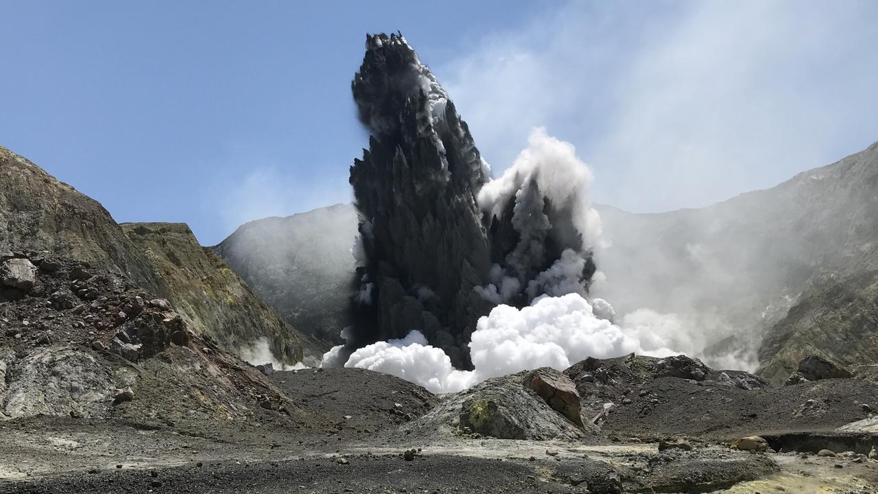 Photos taken of the eruption at 2.12pm by John Cozad. White Island Volcano erupted at 2.11pm, claiming the life of John's son, Chris Cozad. Picture: Supplied by the family