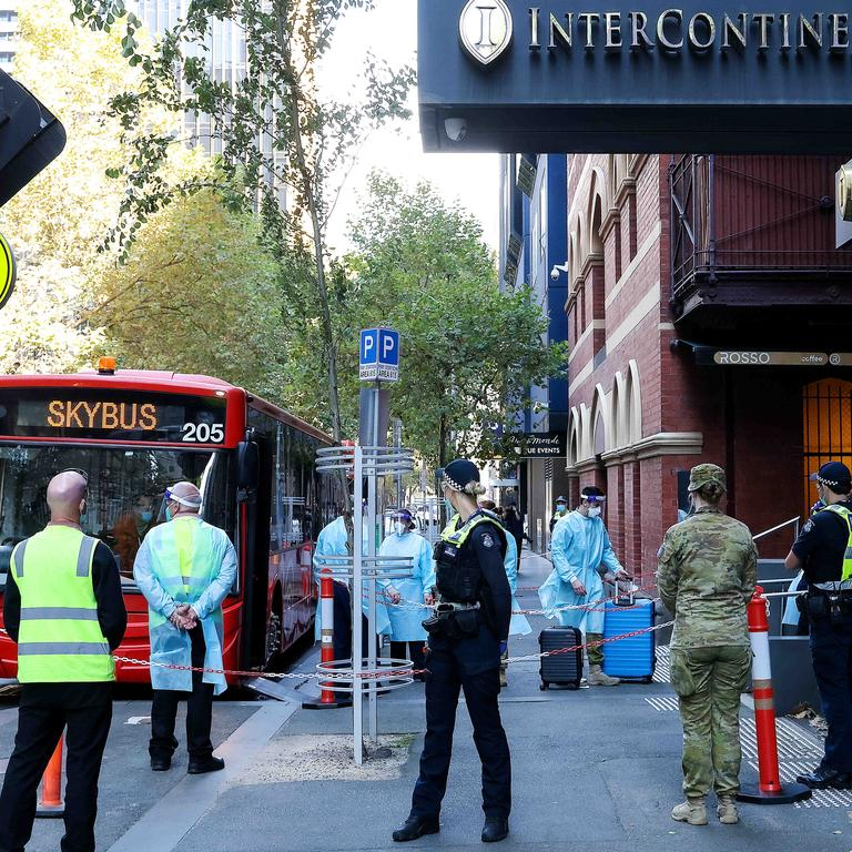 Returning Australian travellers from overseas arrive at the Intercontinental Hotel in Melbourne for their quarantine period. Picture: Ian Currie