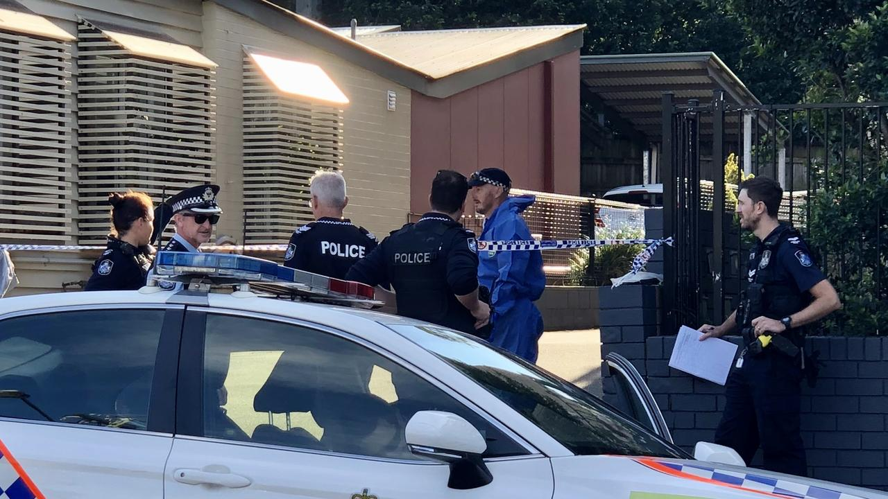 Forensic suit-clad police have swooped on a Brisbane restaurant strip