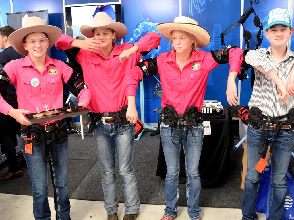 BEEF AUSTRALIA 21: Alexis Heilig, Ella Gleeson, Eleanor Jacobsen and Clare Hills try out the exoskeletons