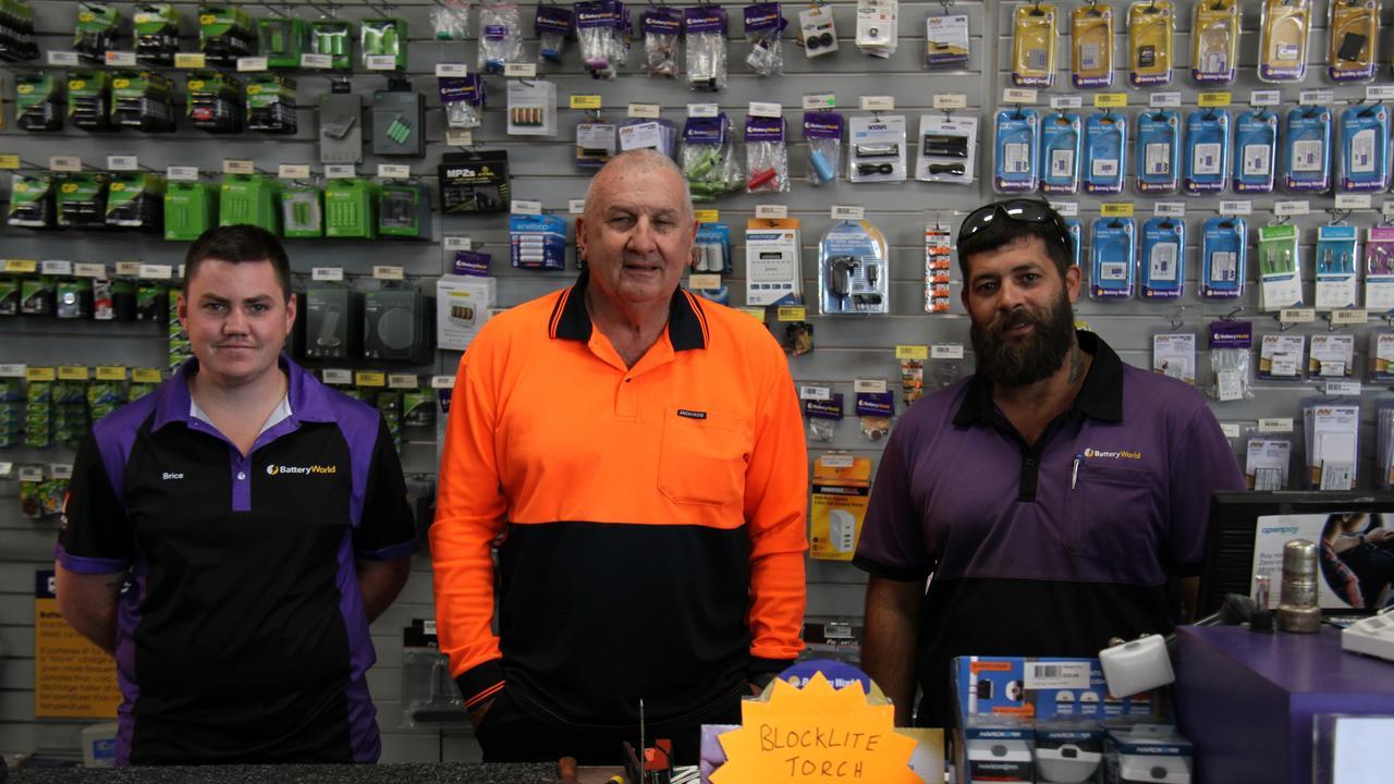 "Gladstone Battery World's Brice Hart, owner David ""Crock"" Thomas and KC Rozycki. Picture: Rodney Stevens"