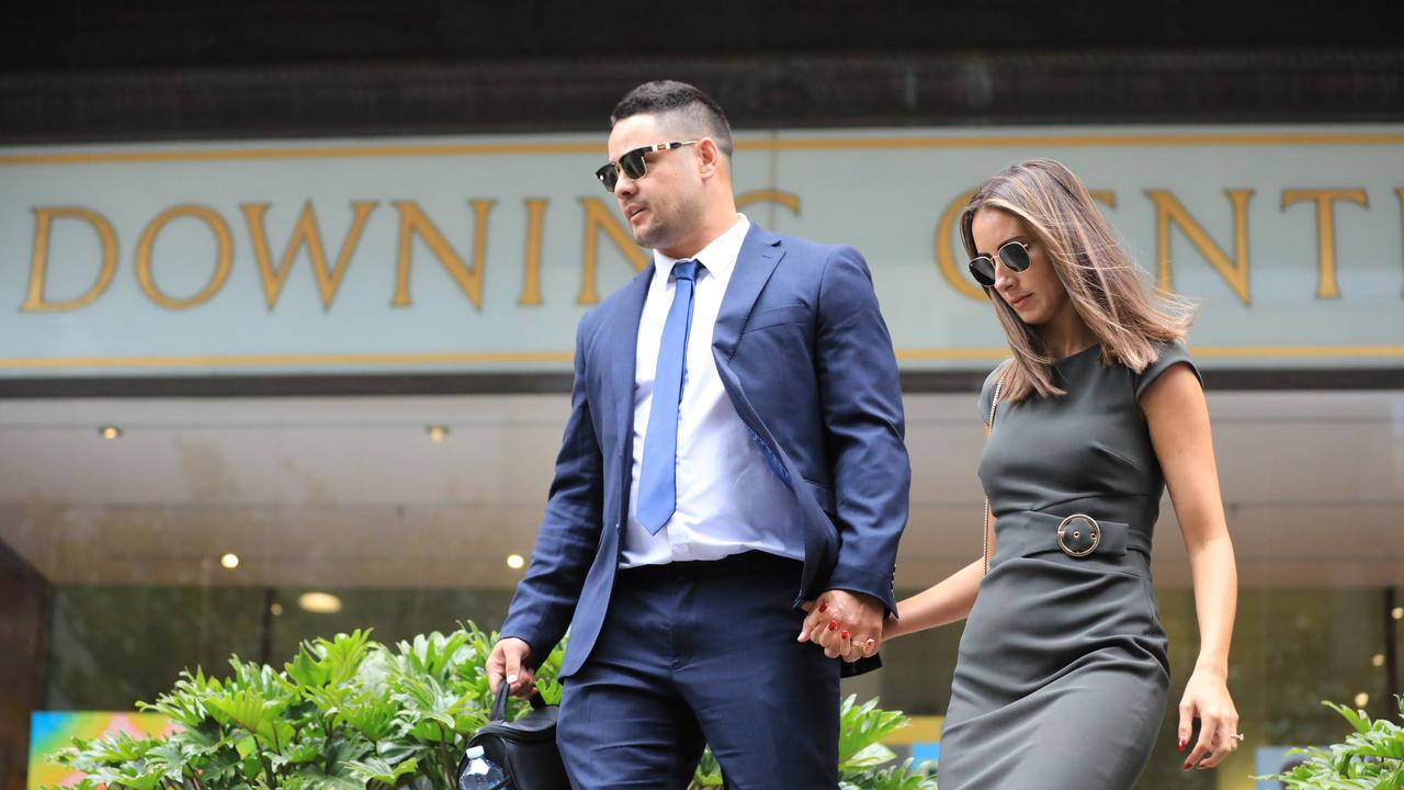 Jarryd Hayne and his wife Amelia Bonnici leaving Downing Centre Court earlier in proceedings. Picture: NCA NewsWire / Christian Gilles