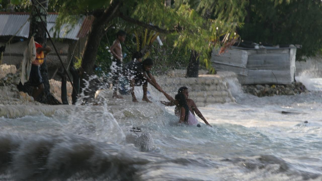 Tarawa island on the Kiribati Islands atoll, Pacific Ocean. King tides cause destruction in the village of Betio.
