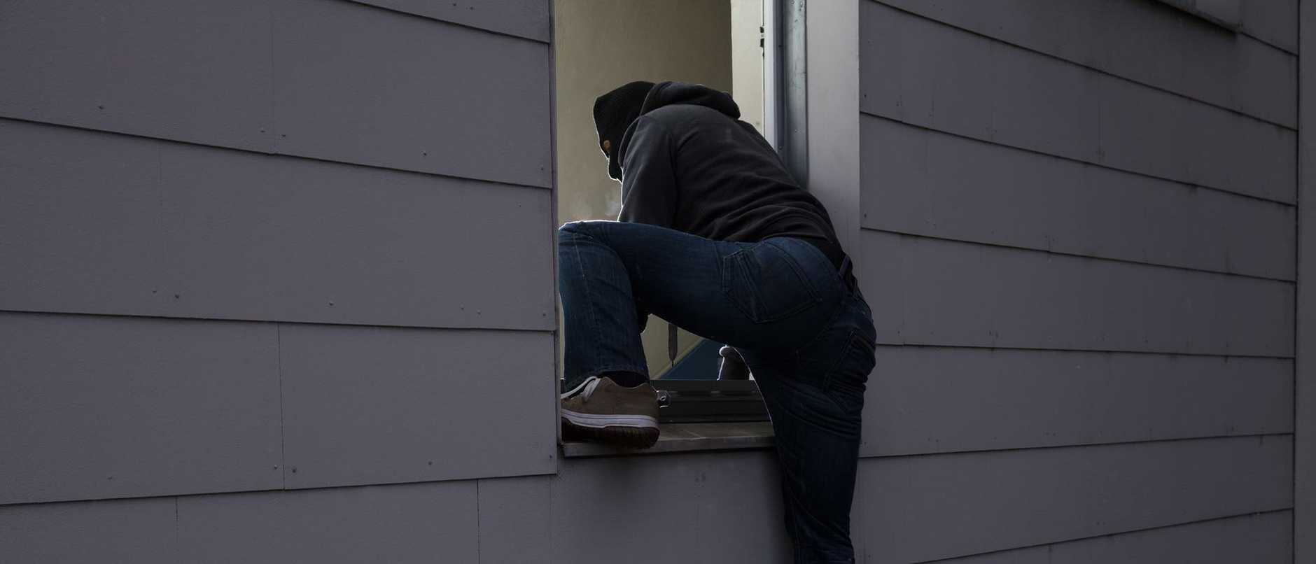 Burglar Entering House Through Window