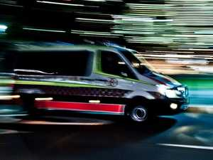 Warrego Hwy driver hospitalised after colliding with tree