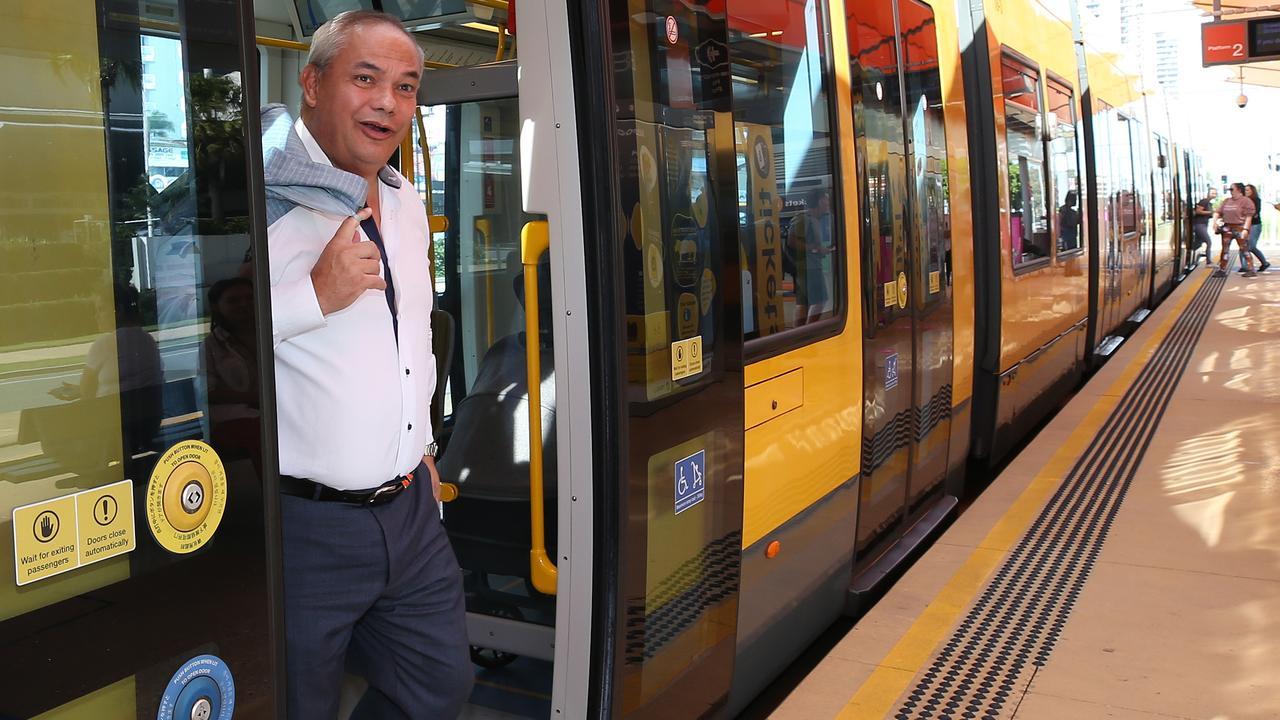 Mayor Tom Tate rides the tram. Picture Glenn Hampson