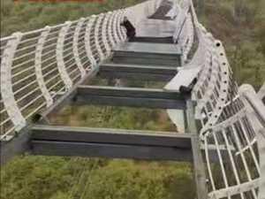 Tourist left dangling as glass bridge breaks