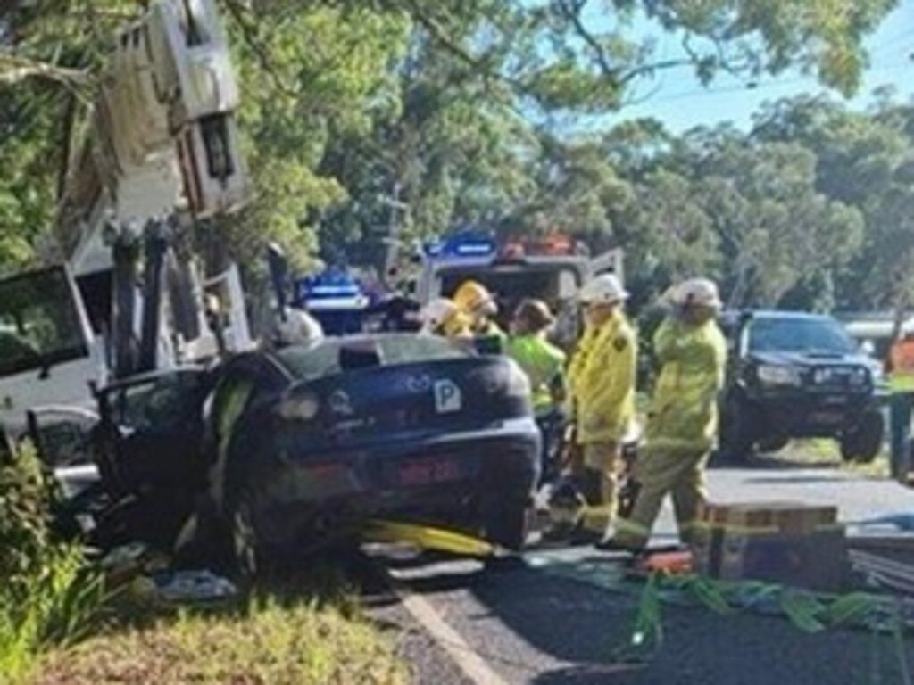 Multiple emergency services crews working to free a pair of young Mooloolah Valley women who suffered horrific injuries in a crash with a crane at Ilkley.