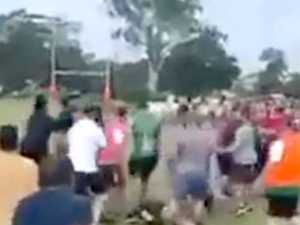 Two men arrested and charged over wild junior footy brawl
