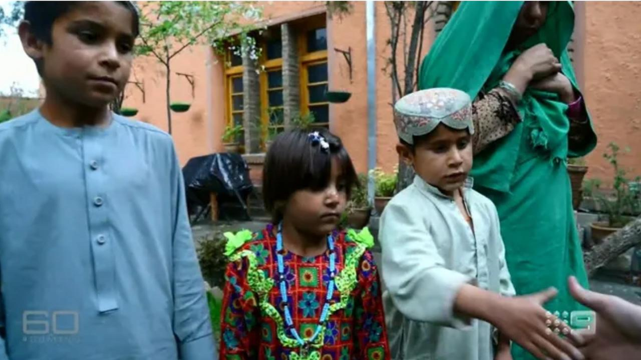 The children of Afghan man Ali Jan, who None Newspapers alleges was pushed off a cliff and shot by Mr Roberts-Smith. Picture: Channel 9