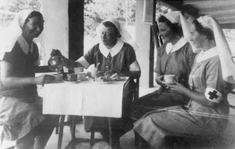 Four sisters of the 2/13th Australian General Hospital enjoying a cup of tea. (left to right): Sister Vivian Bullwinkel; Matron Irene Drummond; Sr M Anderson; Sr M Selwood.