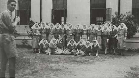 Group portrait of the nursing staff of 2/13th Australian General Hospital
