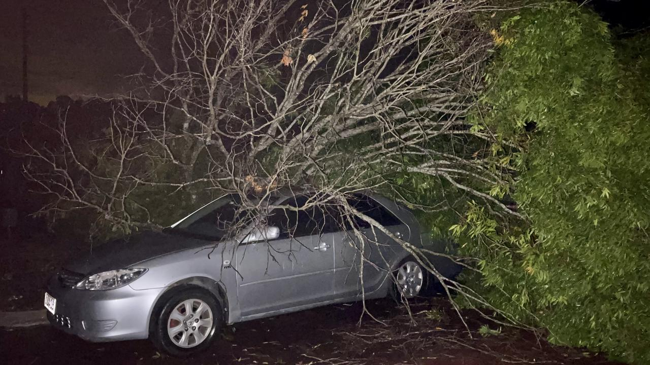 A fallen tree on a car at Nambour after wild storms smashed into southeast Queensland. Picture: Mark Furler