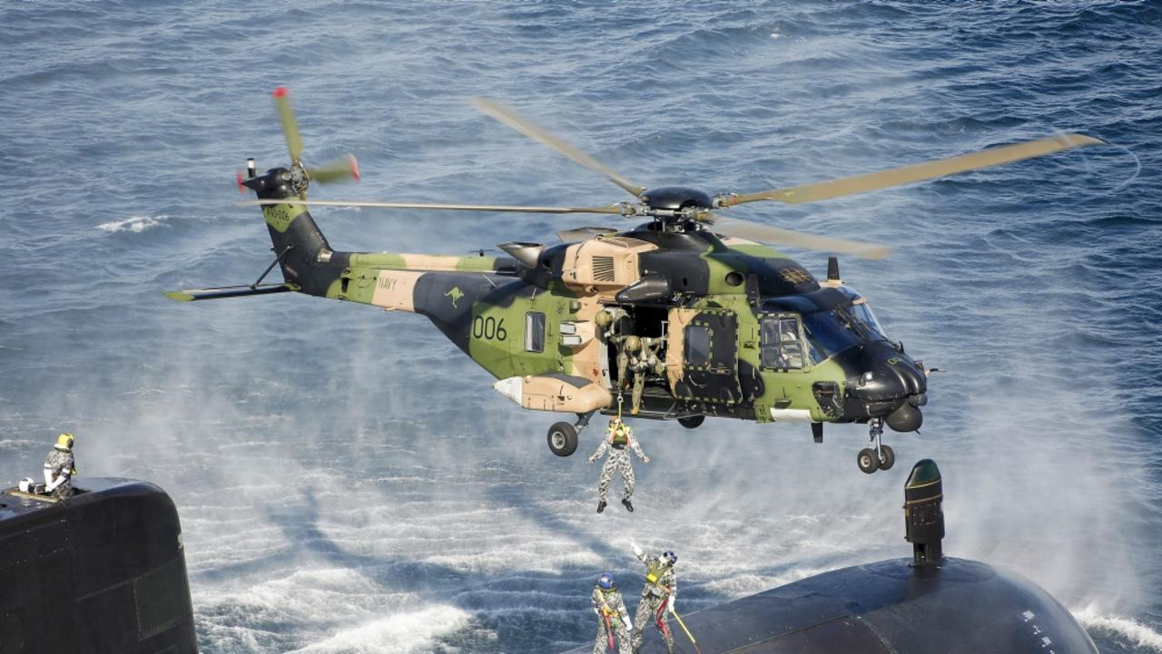 An Australian Submarine conducts personnel transfers with a MRH-90 Taipan helicopter. Picture: Defence
