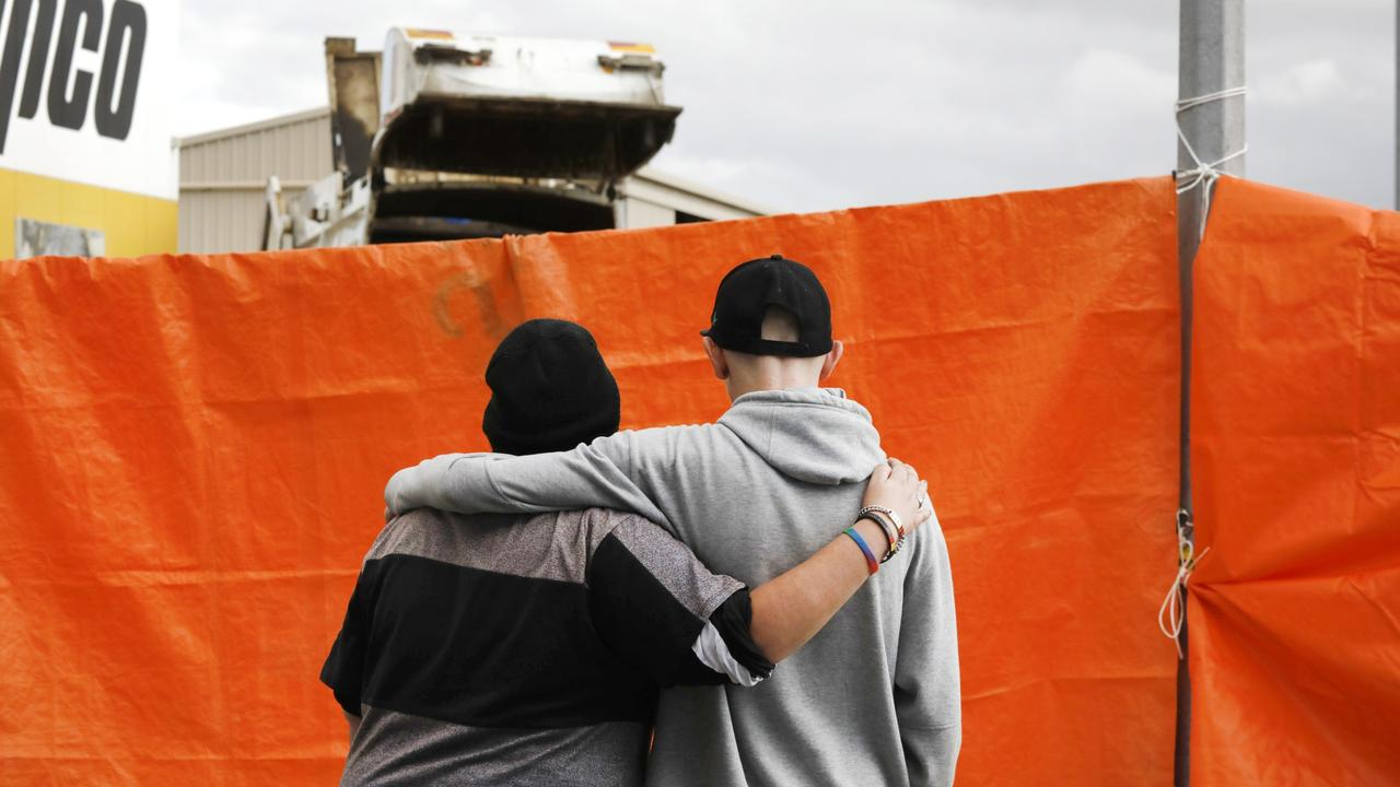 Two people comfort each other at the scene of the accident. Picture: Robert Lang
