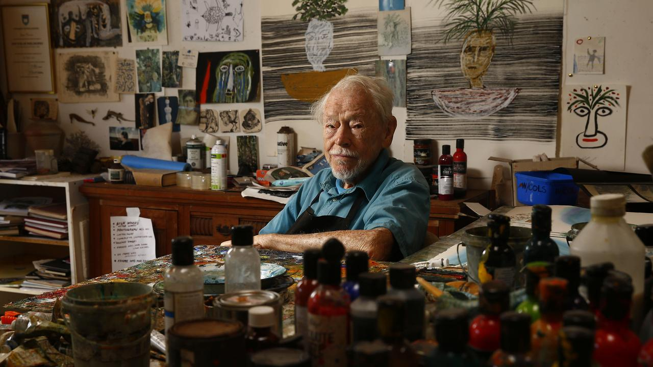 Surrounded by paints and artworks in his studio. Picture: John Appleyard
