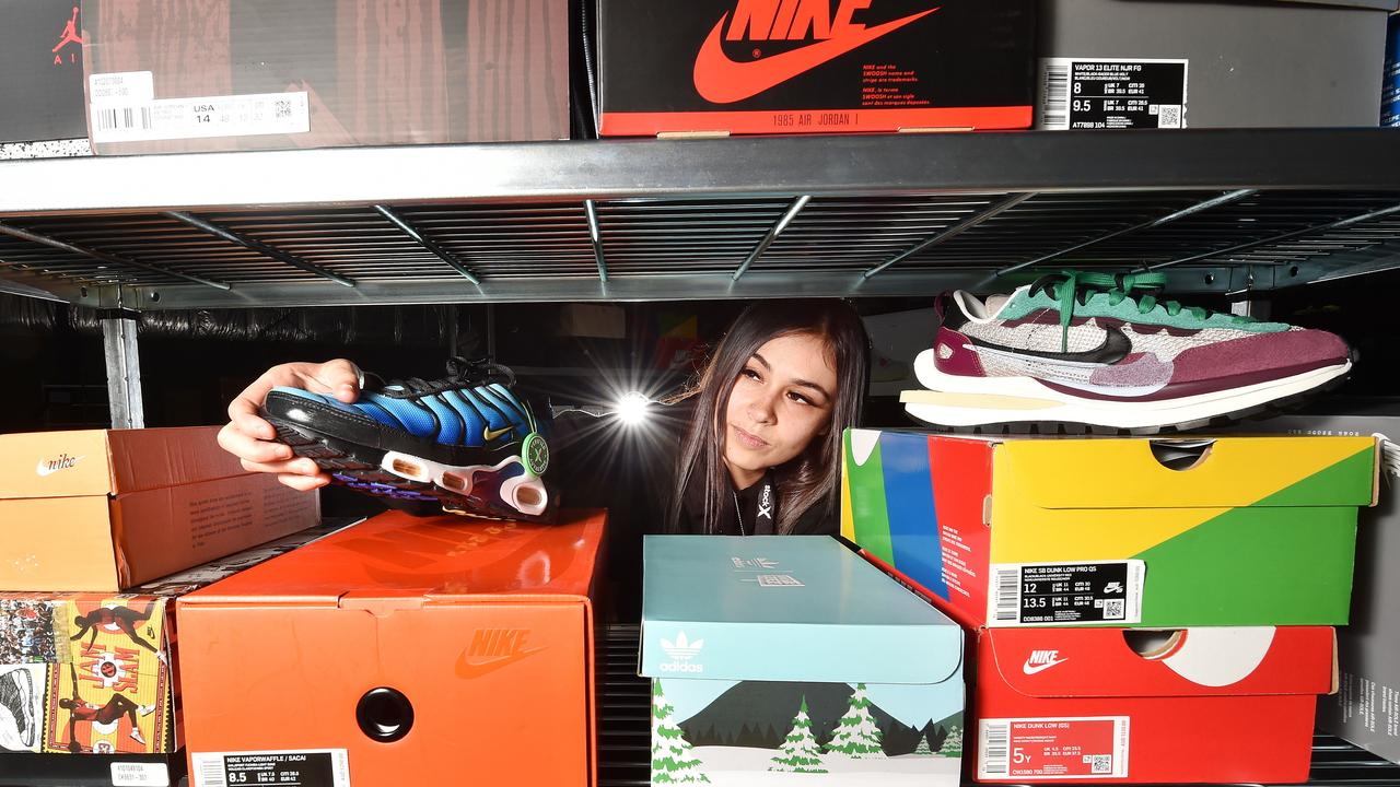 Steph Jones, a Stock X Authenticator, inspecting a shoe. Picture: Nicki Connolly