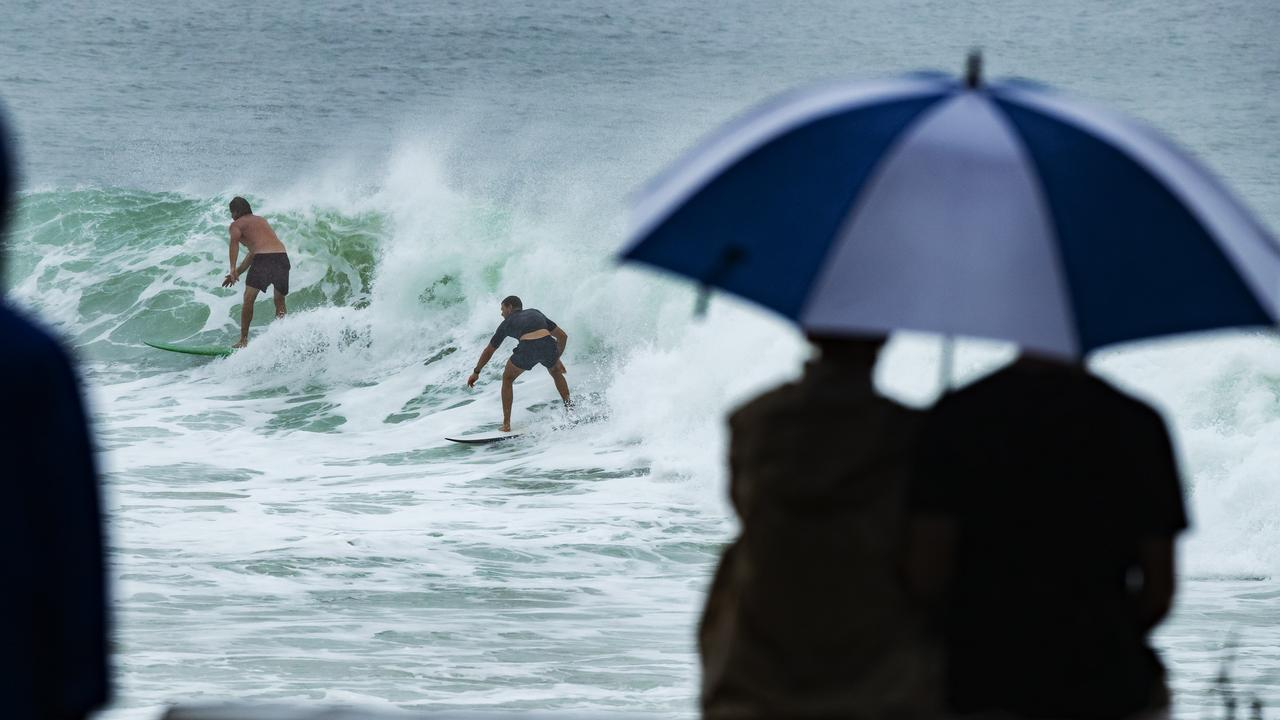 Heavy rainfall hit the region only last week, and more is on the way, but it didn't deter surfers in Noosa National Park. Picture: Lachie Millard