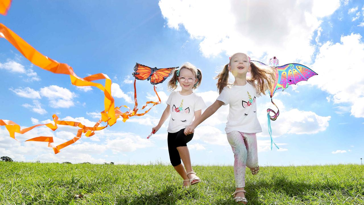 Sisters Lara Kennedy, 5, and Lucy Kennedy, 6, getting excited for the Brisbane Kite Festival. Wynnum is known for its water views and festivals. Picture: Tara Croser