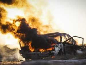 Close call as car bursts into flames in Glenden