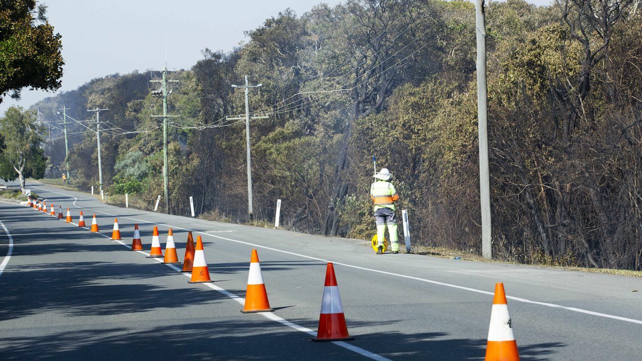 Energex crews work to regain power. Photo Lachie Millard