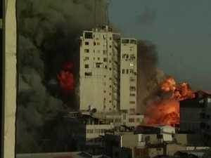 Gaza building collapsing after airstike