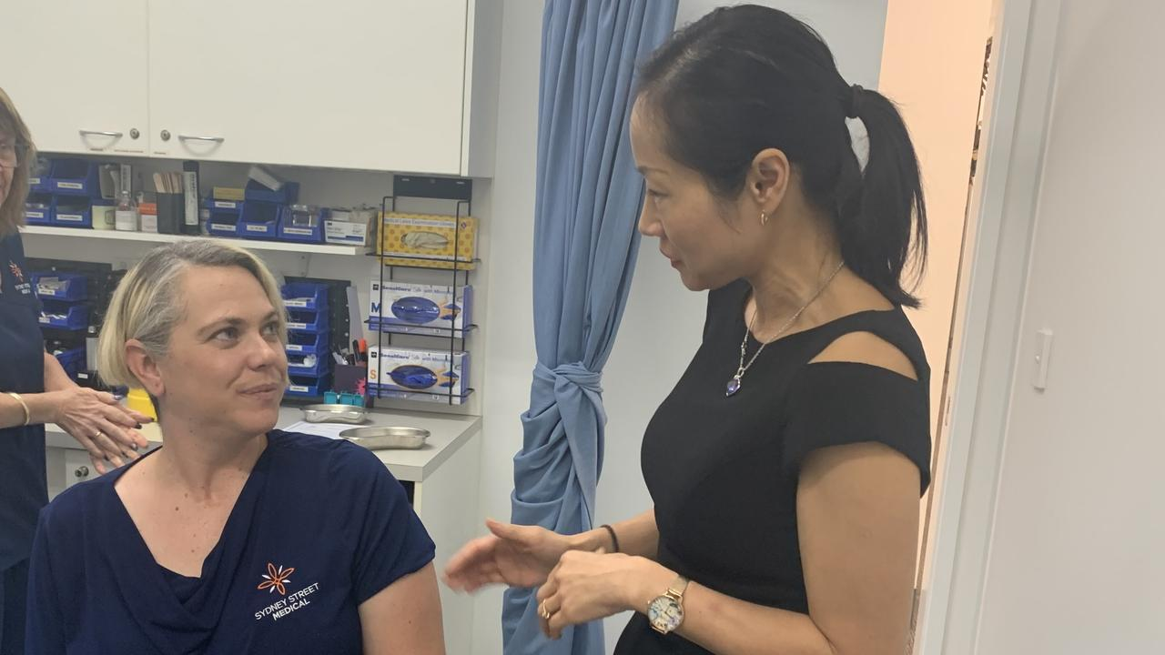 Sydney Street Medical receptionist Belinda O'Reilly talks to GP Dr Shuren Taylor about her flu vaccination. Picture: Melanie Whiting