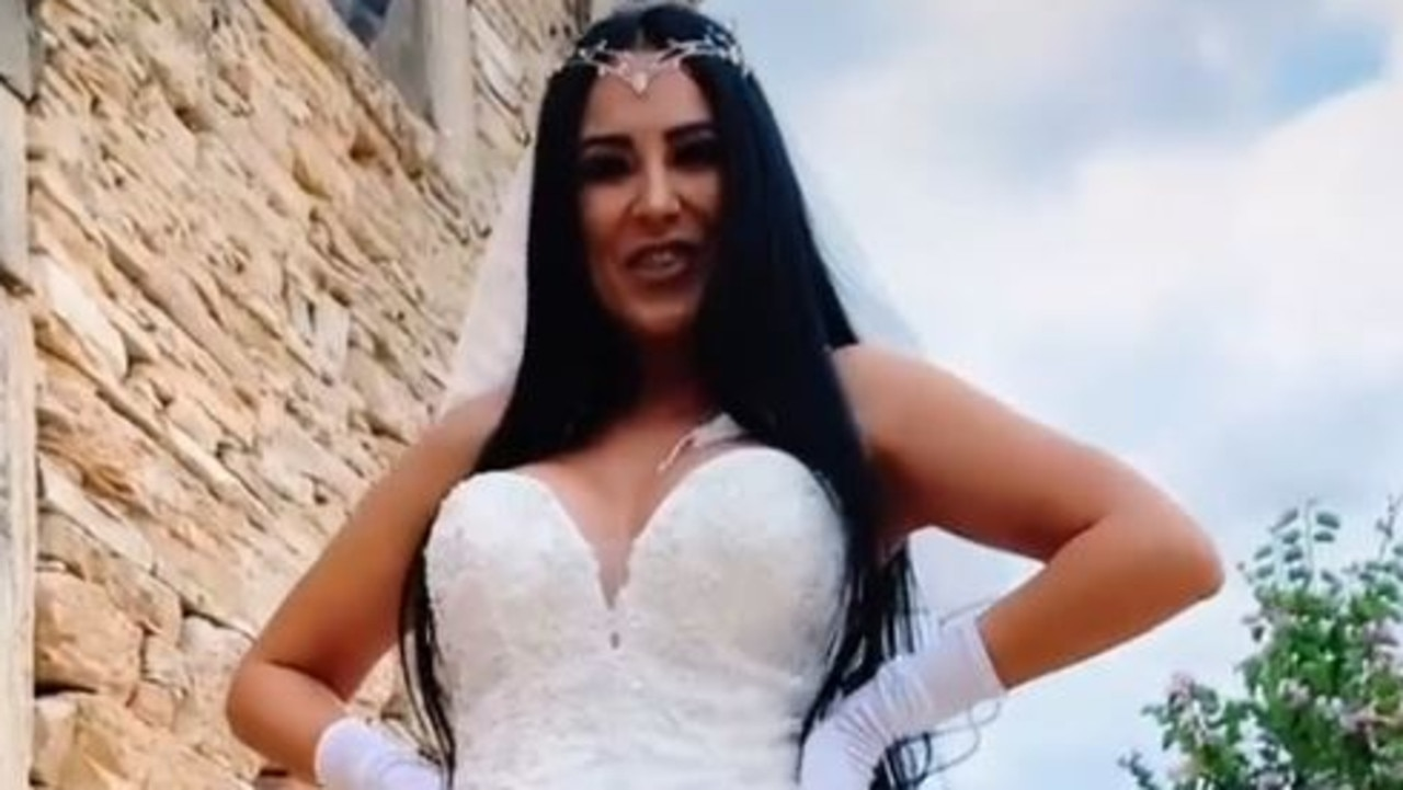 A woman took things to a whole new level with her wedding dress – wearing a see-through grown with a white G-string that flashed her booty.