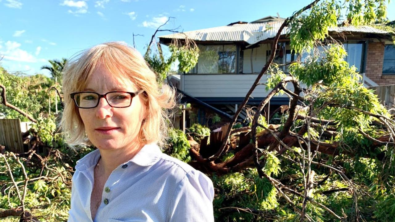 A home on Holly Green Crescent, Palmwoods, was struck by a falling tree during Wednesday night's severe storms. Nearby resident Virginia Hamilton surveys the damage on Thursday morning.