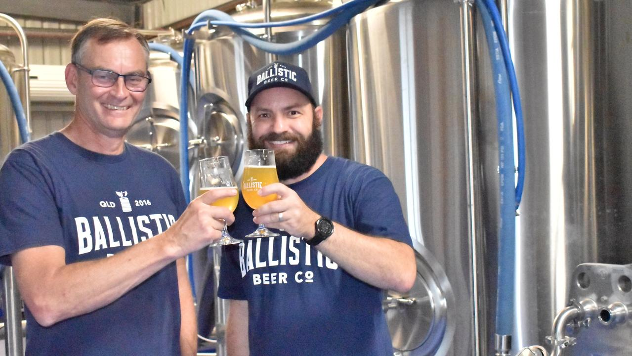 Ballistic Brewing Co's founder David Kitchen and resident Whitsundays brewer Liam Paget celebrate the opening of a new 1000-litre brewery and taphouse at Cannonvale. Picture: Kirra Grimes.