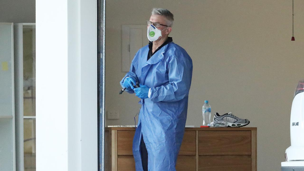 Forensic police investigate the suspicious death of a woman in her Taigum home. Picture: Liam Kidston.